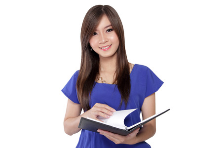 brings: Asian cute woman brings a book, open it page by page and look at the camera, isolated on white background