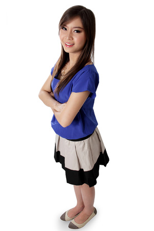 Full body of young Asian woman stand and posing in front of the camera, high angle shot, isolated on white background