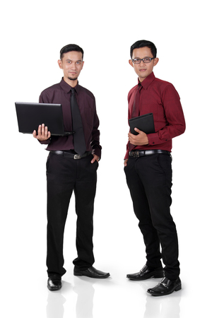 Two male Asian office workers standing with confident pose, full body shot, isolated on white background