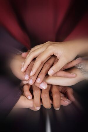 la union hace la fuerza: Business teamwork concept. Close up zoom on a pile of businesspeople hands