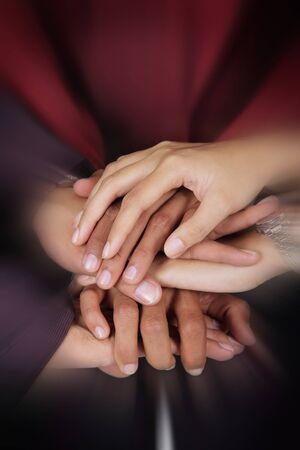 la union hace la fuerza: Business teamwork concept. Close up zoom on a pile of businesspeople hands