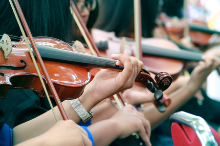 violins: Hands of violinists playing violins outdoor Stock Photo