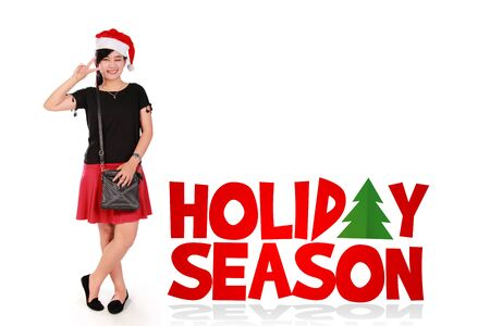 holiday season: Holiday Season, multi-purpose Christmas themed design. Stylish teenage girl in cute pose standing with fun colorful graphic text over white background