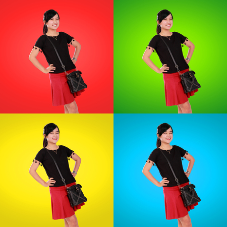 gleeful: Composition of gleeful Asian girl posing confidently, isolated over eye-catching colorful background Stock Photo