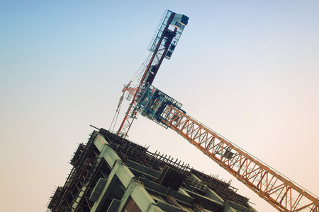 A steel tower and apartment scaffolding on a construction site