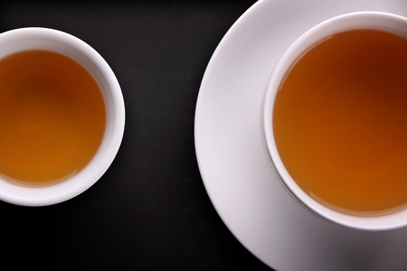 overhead shot: Composition of two tea cups closeup in overhead shot concept image
