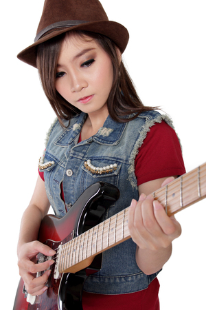 calm woman: Beautiful Asian guitarist girl plays her instrument with cool attitude, isolated on white background