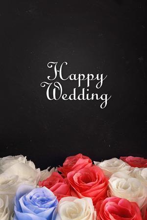 cursive: Happy wedding, congratulation card design with elegant cursive text on top of colorful flowers arrangement