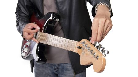 lead guitar: Tuning electric guitar close up hand, isolated on white background