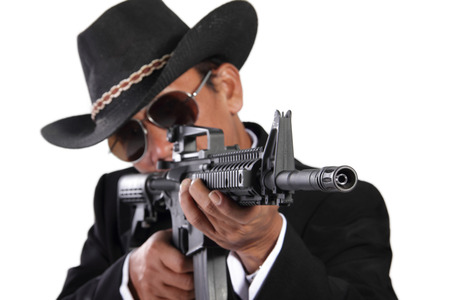 assassin: Close up portrait of a professional assassin hitting target with a gun, isolated on white background Stock Photo