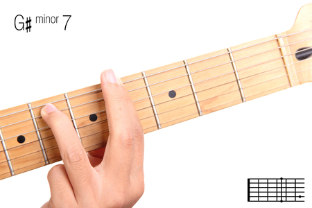chord: G#m7 - minor seventh keys guitar tutorial series. Closeup of hand playing G sharp minor seventh chord on guitar, isolated on white background Stock Photo