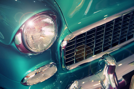 car grill: Green vintage car headlight, bumper and grill