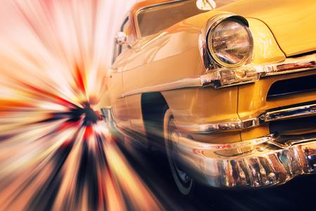Gold metallic vintage car in high speed motion