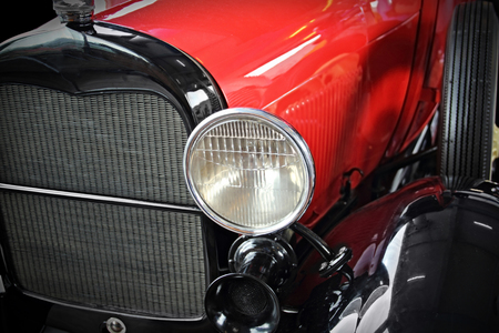 early 30s: Close up of red old antique car Stock Photo