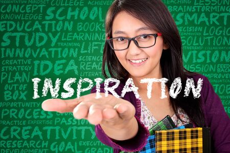 open type font: Smiling young Asian woman showing the word Inspiration on her hand. Education concept design with chalkboard typography