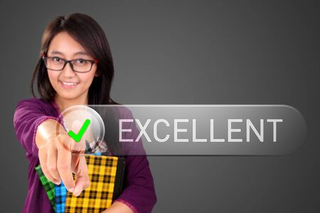 futuristic girl: Conceptual image of smart girl pushing on button of the word Excellent in modern futuristic design