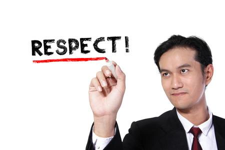 """respetar: hombre de negocios que subraya la palabra """"respeto"""" en la pantalla, sobre fondo blanco Foto de archivo"""