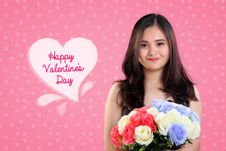 teenage girl happy: Happy Valentines Day background design with portrait of cute Asian teenage girl holding colorful roses bouquet on pink
