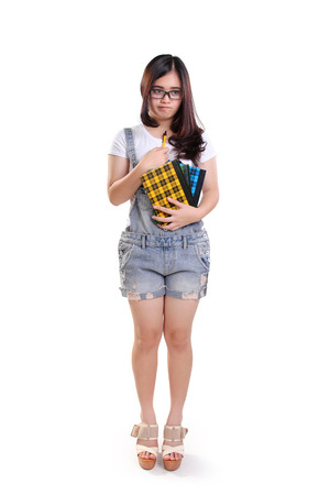 anxious face: Full length portrait of geeky school girl standing with disappointed face, isolated on white background