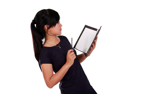 Side portrait of Asian girl reading from a notebook with serious face, isolated on white background