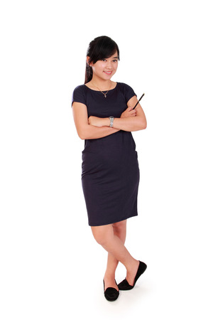 confidently: Full body portrait of young female Asian entrepreneur standing confidently, isolated on white background