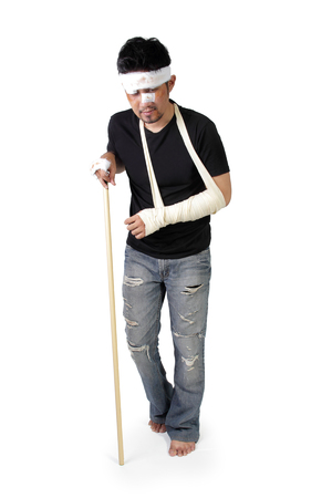 lame: Full body portrait of an upset injured man walking with disability stick, isolated on white background
