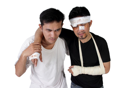 An injured victim evacuated with a help from a man, isolated on white background