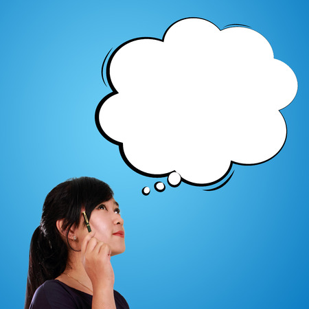 thinking bubble: Face of thoughtful woman with empty thinking bubble above her head, over blue background Stock Photo
