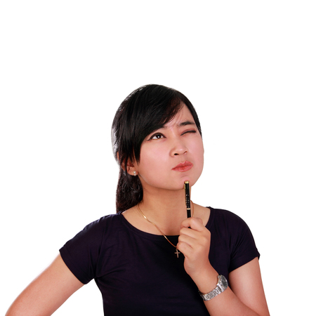 insightful: Insightful face of young Asian woman looking up to empty space at the top, isolated on white background Stock Photo