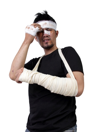 groaning: Portrait of Asian man in bandage and gypsum groaning in pain, isolated on white background