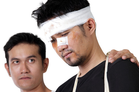 down beat: Close up face of injured man looking down and his friend looking at him with compassion, isolated on white background Stock Photo