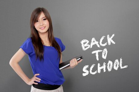 smart girl: Back to school. Education concept design with portrait of smart Asian girl standing over blackboard background