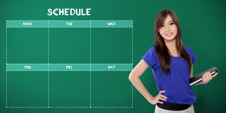 school schedule: Fun weekdays school schedule template design, with image of happy female Asian student over green chalkboard background Stock Photo