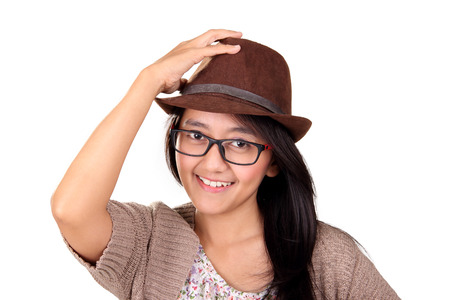 fedora: Close up face of smiling Asian woman wearing nerd glasses and fedora hat, isolated on white background