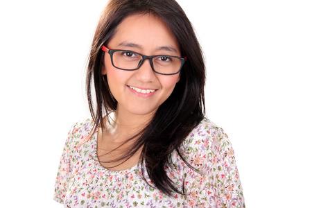 headshot: Headshot portrait of lovely Asian female adult smiling at camera, isolated on white background Stock Photo