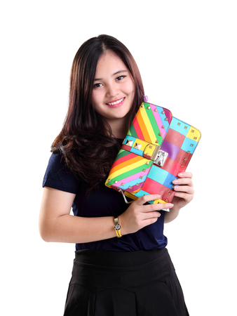 hand bag: Portrait of beautiful smiling Asian girl holding a cute colorful hand bag, isolated on white background