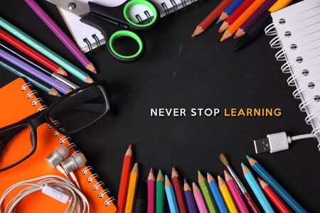 lay: Never Stop Learning. Educational concept design with image of some school supplies