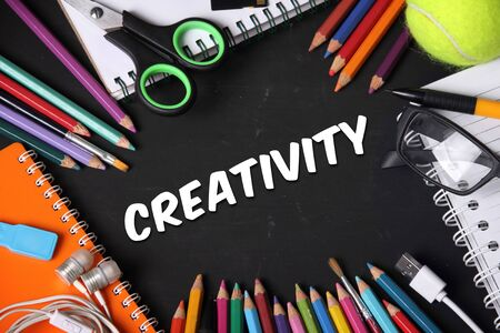 new generation: Creativity. Conceptual design with image of creative people essentials on blackboard