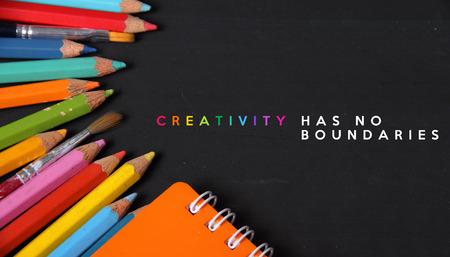 has: Creativity has no boundaries. Creative equipments on blackboard background