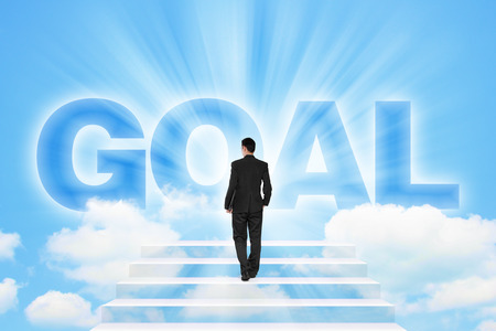 stairway to heaven: Businessman walking on a stairway to GOAL over the white cloud