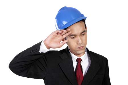 exhaustion: Close up portrait of a tired construction worker expressing exhaustion, isolated on white background Stock Photo