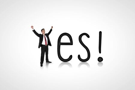 young male model: Yes! Conceptual composition of a happy expressive businessman and alphabet Stock Photo