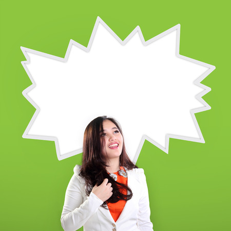 special education: Happy excited Asian businessman woman looking up at empty comic splash, over green background