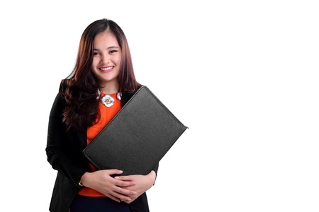 business attire teacher: Happy beautiful young Asian female secretary smiling at camera, isolated on white background with copy space Stock Photo