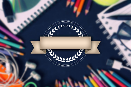 copyspace: Decorative vintage label design with ribbon for copyspace, over abstract blurred image of school supplies - conceptual education background