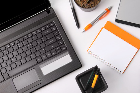 overhead shot: Composition of some office equipments on a desk, overhead shot over white background Stock Photo