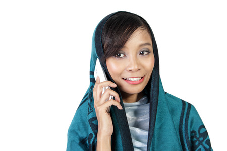 handphone: Close up portrait of a muslim woman talking on her cellphone, isolated on white background Stock Photo