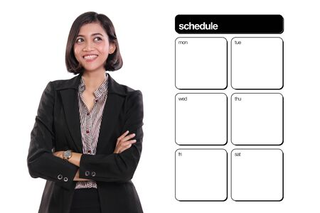 appointment book: Smiling confident businesswoman with arms crossed, looking at schedule template on her side, isolated on white background Stock Photo