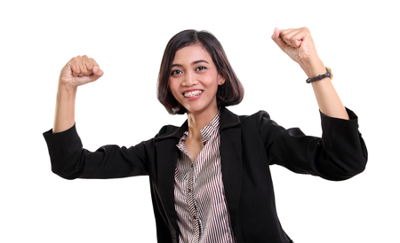 powerful creativity: Confident successful Asian business woman raising both hands in victory, isolated on white background
