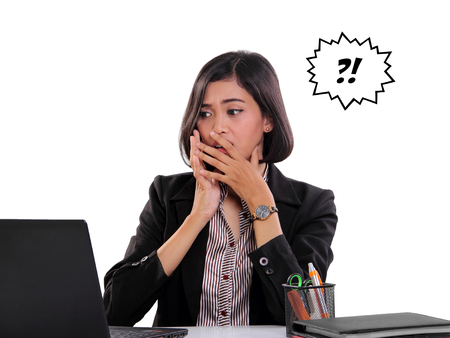 confused face: Shocked face expression of a businesswoman seeing something on laptop screen, isolated on white background